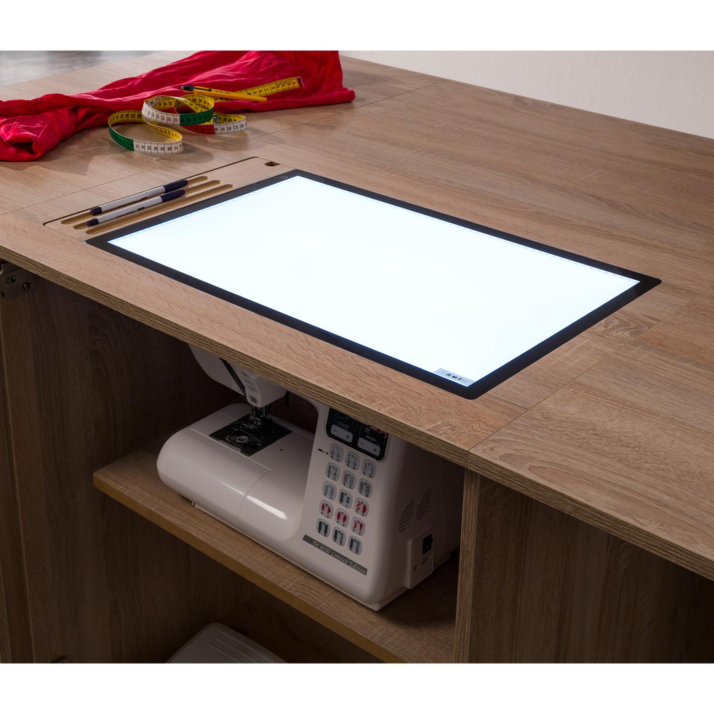 Hier das optional erhältliche LED-LightPad, dass anstelle der Freiarmeinlage eingelegt werden kann.